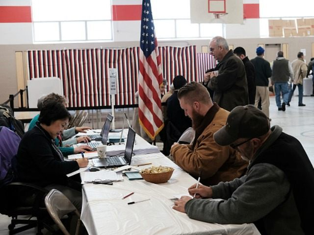 People vote inside of a middle school serving as a voting station on the day of the New Hampshire Primary on February 9, 2016 in Bow, New Hampshire. After months of campaigning, voters across New Hampshire get to go to the polls today to vote for Democratic and Republican presidential …