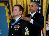 President Barack Obama presents the Medal of Honor to Senior Chief Special Warfare Operator Edward Byers during a ceremony in the East Room of the White House in Washington, Monday, Feb. 29, 2016. Byers received the Medal of Honor for his courageous actions while serving as part of a team …
