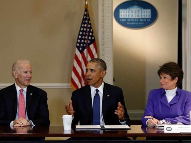 President Barack Obama speaks during a meeting of the Democratic Governors Association while Vice President Joe Biden (3L) and Senior Advisor to the President Valerie Jarrett (2R) listen at the Eisenhower Executive Office Building at the White House on February 19, 2016 in Washington, DC.