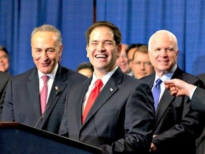 """There are smiles all around as immigration reform legislation is outlined by the Senate's bipartisan """"Gang of Eight"""", on Capitol Hill in Washington, Thursday, April 18, 2013. From left to right are Sen. Jeff Flake, R-Ariz., Sen. Chuck Schumer, D-N.Y., Sen. Marco Rubio, R-Fla., and Sen. John McCain, R-Ariz. The legislation would dramatically remake the U.S. immigration system, ushering in new visa programs for low- and high-skilled workers, requiring a tough new focus on border security, instituting a new requirement for all employers to check the legal status of their workers, and installing a path to citizenship for 11 million immigrants in the country illegally. (AP Photo/J. Scott Applewhite)"""