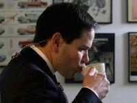 NASHUA, NH - FEBRUARY 08:  Republican presidential candidate Sen. Marco Rubio (R-FL) sips coffee before doing a television interview at Norton's Classic Cafe during a campaign stop February 8, 2016 in Nashua, New Hampshire. Rubio is hoping for a good showing on Tuesday when people in New Hampsire head to the polls in the 'First in the Nation' presidential primary.  (Photo by Chip Somodevilla/Getty Images)