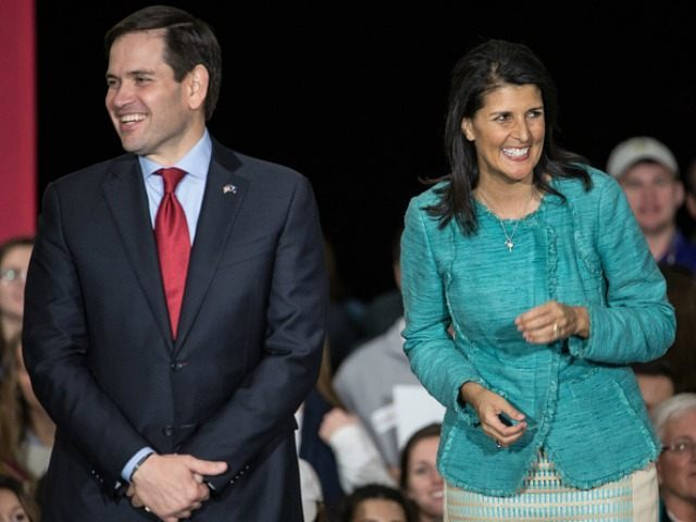 Republican presidential candidate Marco Rubio, left, and South Carolina Governor Nikki Haley share a laugh with the crowd at a campaign rally at Clemson University Friday, February 19, 2016 in Clemson, South Carolina.
