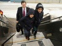 Republican presidential candidate Sen. Marco Rubio (R-FL) and his sons Anthony and Dominick walk across the tarmac before departing from Manchester-Boston Regional Airport February 10, 2016 in Manchester, New Hampshire.