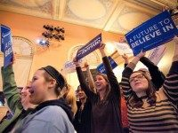 Supporters of Democratic presidential candidate Sen. Bernie Sanders (I-VT) cheer as Sanders speaks at the Claremont Opera House on February 2, 2016 in Claremont, New Hampshire. The New Hampshire primary is February 9. (Photo by
