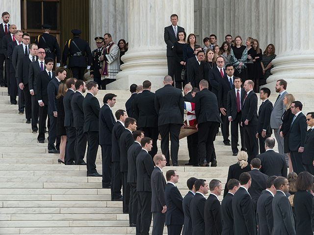 The casket of U.S. Supreme Court Justice Antonin Scalia arrives at the Supreme Court in Washington, DC, on February 19, 2016, where it will lie in repose until his funeral at the Basilica of the National Shrine of the Immaculate Conception on February 20. (Nicholas Kamm/AFP/Getty Images)