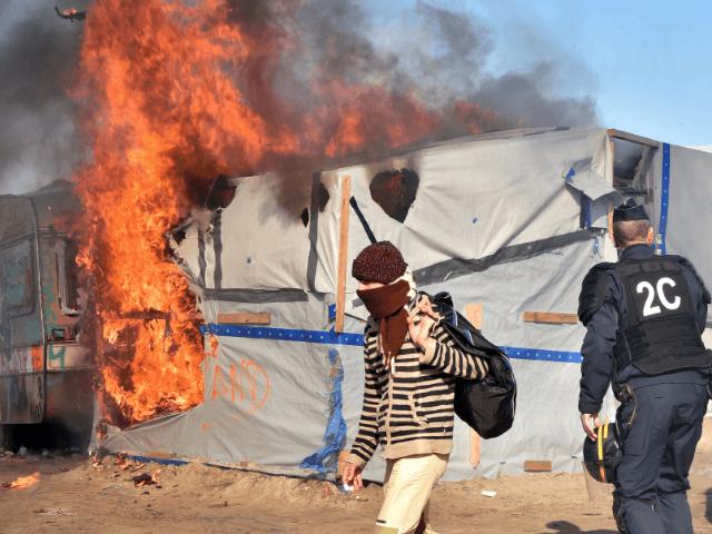 Calais migrant fire riot