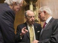 Senate Judiciary Committee Chairman Sen. Chuck Grassley, R-Iowa, center, Sen. John Cornyn, R-Texas, the majority whip, left, and Sen. Jeff Sessions, R-Ala., right, confer before a hearing on Capitol Hill in Washington, Tuesday, Feb. 23, 2016. Senate Republicans, most notably Majority Leader Mitch McConnell, are facing a high-stakes political showdown …