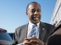 Republican presidential candidate Ben Carson speaks to reporters after stopping at The Airport Diner on February 7, 2016 in Manchester, New Hampshire.