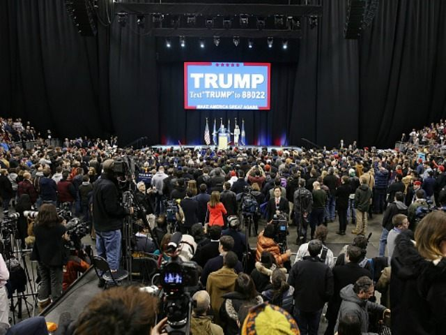 People listen as Republican presidential candidate Donald Trump speaks during a campaign rally at Verizon Wireless Arena on February 8, 2016 in Manchester, New Hampshire. Democratic and Republican Presidential candidates are finishing up with the last full day of campaigning before voters head to the polls tomorrow. (Photo by )