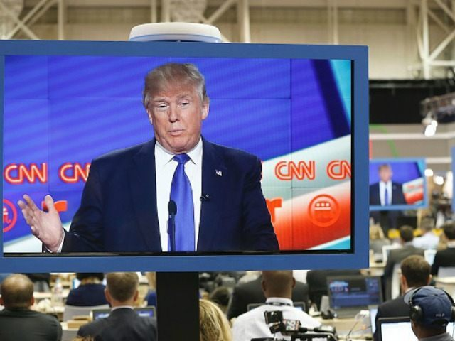 Republican Presidential Candidate Donald Trump is seen on television in the CNN filing room during the Republican Presidential Debate at the University of Houston in Houston, Texas on February 25, 2016.