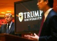 FILE - In this May 23, 2005 file photo, Donald Trump, left, listens as Michael Sexton, president and co-founder of the business education company, introduces him to announce the establishment of Trump University at a press conference in New York. Long before Trump's seductive mix of optimism and hyperbole proved …