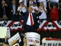 Republican presidential candidate Donald Trump waves as he is introduced during a campaign rally at the University of South Florida Sun Dome on February 12, 2016.