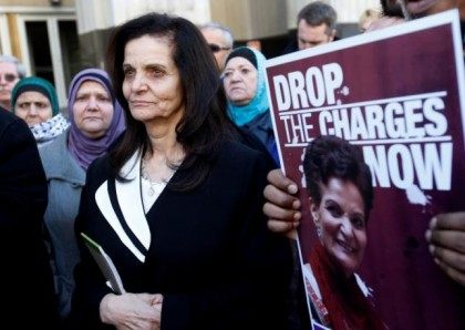 Palestinian activist Rasmieh Yousef Odeh (C) stands outside the federal courthouse after her sentencing in Detroit, Michigan March 12, 2015.