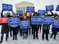 WASHINGTON, DC - FEBRUARY 15: People For the American Way activists rally outside of the Supreme Court, calling on Congress to give fair consideration to President Obama's nominee to the Supreme Court of the United States on February 15, 2016 in Washington, DC. (Photo by Larry French/Getty Images for People …