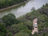 U.S. Border Patrol vehicle searches for drug smugglers near the Rio Grande at the U.S.-Mexico border on May 21, 2013 near Hidalgo Texas. The Rio Grande Valley area has become the busiest sector for illegal immigration on the entire U.S.-Mexico border with more than a 50 percent increase in the …