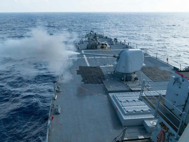 This US Navy photo obtained February 1, 2016 shows the Arleigh Burke-class guided-missile destroyer USS Curtis Wilbur as it conducts a live fire gunnery exercise on January 15, 2016 in the South China Sea
