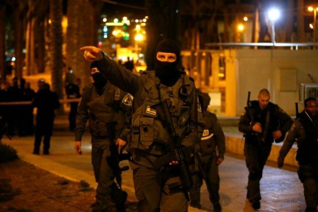 Israeli police officers stand guard at the scene where a Palestinian man was shot dead by Israeli security forces following a reported attack near Damascus Gate, a main entrance to Jerusalem's Old City on February 14, 2016
