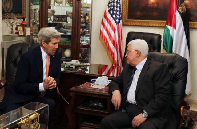 US Secretary of State John Kerry meets with Palestinian President Mahmud Abbas (R) at the Palestinian ambassador's residence on February 21, 2016 in the Jordanian capital Amman
