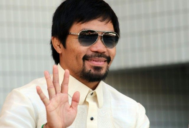 Philippines' eight-time world boxing champion Manny Pacquiao, a former street kid with little education, has used his fame and fortune to launch a political career