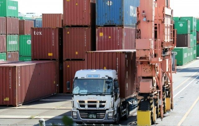 Japan swung back to a trade deficit in January as exports to China plunged, official data shows