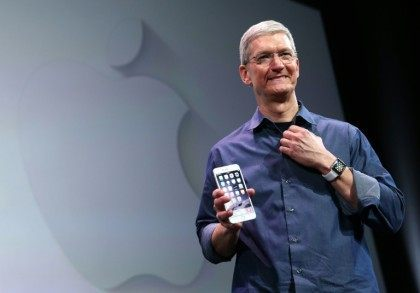 Apple CEO Tim Cook shows off the iPhone 6 on September 9, 2014 in Cupertino, California