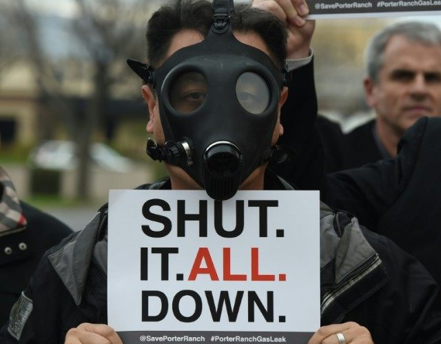 A resident wears a gas mask as he joins others in a protest outside a meeting of the Air Quality Management Board over the gas leak in Porter Ranch, California on January 23, 2016
