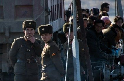 North Korean soldiers stand on a boat on the Yalu River in the North Koreantown of Sinuiju, as seen from across the river from the Chinese border town of Dandong on February 9, 2016