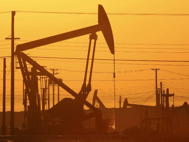 Oil prices rose after energy giants Saudi Arabia and Russia agreed to freeze crude output at January levels