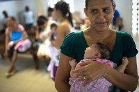 A Brazilian mother holds her baby daughter who is suffering from microcephaly, a birth defect that scientists say is linked to the Zika virus