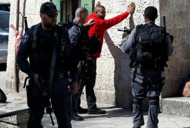 Israeli police body-check a Palestinian youth at Damascus Gate in the Old City of Jerusalem