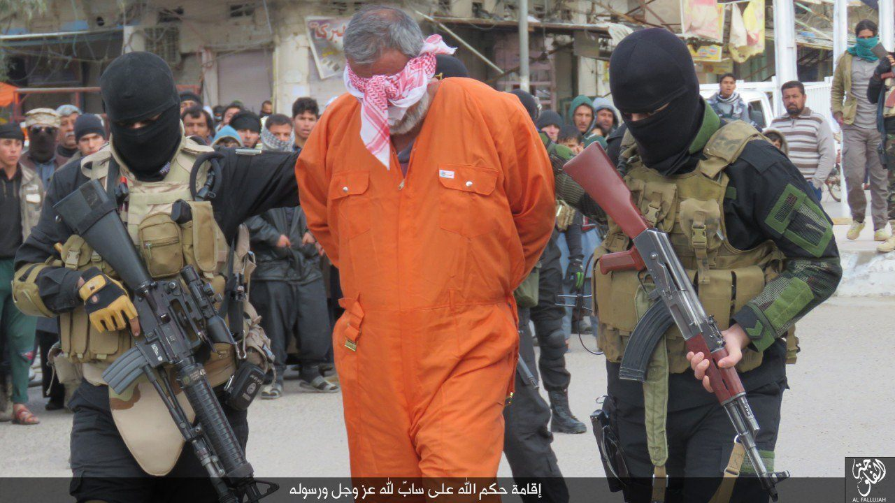 "The Islamic State organization has published pictures of its militants executing an Iraqi man who was accused of ""cursing"" Allah."