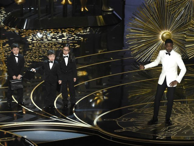 Host Chris Rock, right, and children participate in a skit at the Oscars on Sunday, Feb. 28, 2016, at the Dolby Theatre in Los Angeles. (Photo by Chris Pizzello/Invision/AP)
