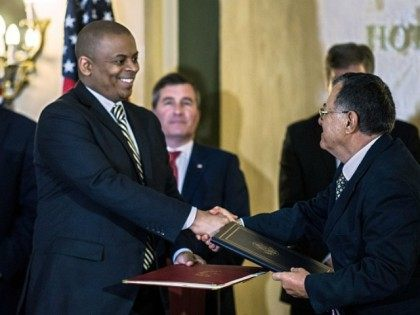 Transportation Secretary Anthony Foxx (L) and Cuban Minister of Transportation Adel Yzquierdo shake hands after signing an agreement authorizing up to 110 scheduled daily commercial flights to Havana and nine other destinations on the island at National Hotel in Havana, on February 16, 2016.
