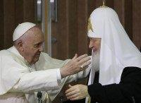 Pope Francis, left, reaches to embrace Russian Orthodox Patriarch Kirill after signing a joint declaration at the Jose Marti International airport in Havana, Cuba, Friday, Feb. 12, 2016. The two religious leaders met for the first-ever papal meeting, a historic development in the 1,000-year schism within Christianity. (AP Photo/Gregorio Borgia, Pool)