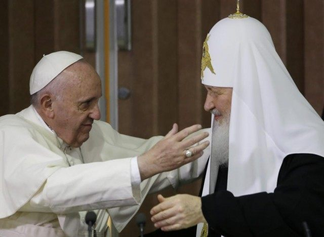 Pope Francis, left, reaches to embrace Russian Orthodox Patriarch Kirill after signing a joint declaration at the Jose Marti International airport in Havana, Cuba, Friday, Feb. 12, 2016. The two religious leaders met for the first-ever papal meeting, a historic development in the 1,000-year schism within Christianity. (AP Photo/Gregorio Borgia, …