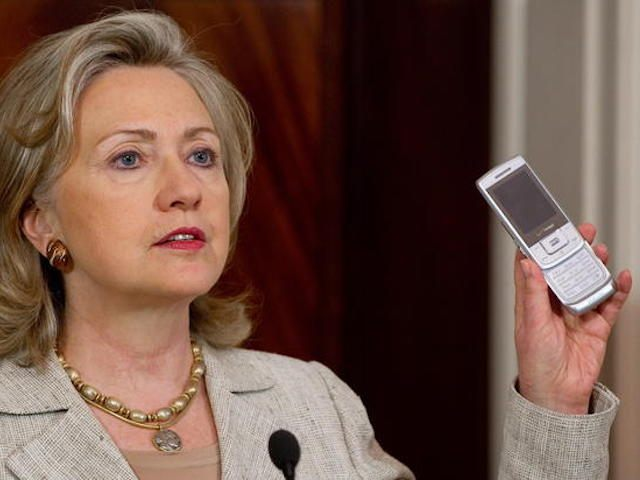 US Secretary of State Hillary Clinton holds up a cell phone as she explains how Americans can donate via text message to aid in helping victims of severe flooding in Pakistan, during a statement at the State Department in Washington, DC, August 4, 2010. AFP PHOTO / Saul LOEB (Photo credit should read SAUL LOEB/AFP/Getty Images)