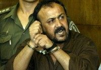 "Marwan Barghouti, 43, (R), general secretary of Palestinian [President Yasser Arafat's Fatah ] movement in the West Bank, speaks to the press as his attourney Jamal Bulous (L) tries to stop him at Tel Aviv's city court on August 14, 2002. Shouting in Hebrew, ""the Intifada will win"", Marwan Barghouti …"