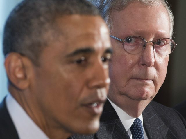 US President Barack Obama speaks alongside Senate Majority Leader Mitch McConnell (R), Republican of Kentucky, prior to a meeting of the bipartisan, bicameral leadership of Congress in the Cabinet Room at the White House in Washington, DC, January 13, 2015. AFP PHOTO / SAUL LOEB (Photo credit should read SAUL …