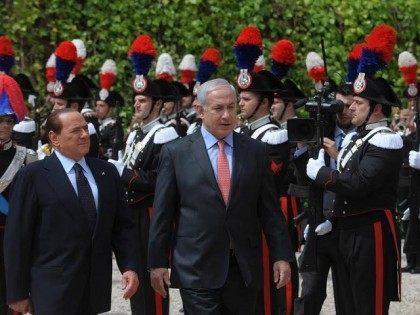 Israeli Prime Minister Benjamin Netanyahu and his Italian counterpart Silvio Berlusconi review an honour guard, at Villa Madama June 13, 2011 in Rome, Italy.