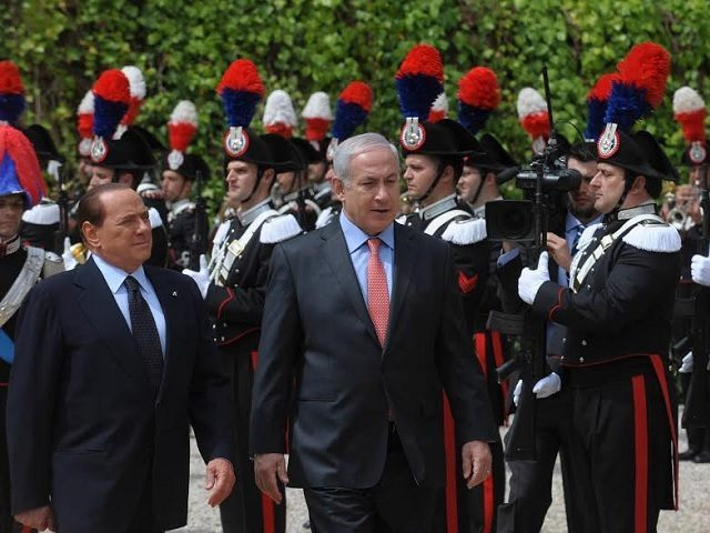 Israeli Prime Minister Benjamin Netanyahu and his Italian counterpart Silvio Berlusconi review an honour guard, at Villa Madama June 13, 2011 in Rome, Italy.