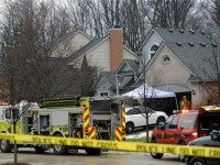 Police and fire officials investigate a house fire that killed five people at a home in Novi, Mich., Sunday, Jan. 31, 2016. Authorities say five restaurant workers were killed in the house fire near Detroit. The cause of the blaze is under investigation. (Brandy Baker/Detroit News via AP) DETROIT FREE PRESS OUT; HUFFINGTON POST OUT; MANDATORY CREDIT