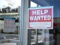 Help Wanted' sign is posted in the window of an automotive service shop on March 8, 2013 in El Cerrito, California.