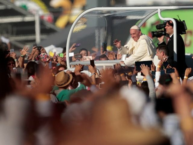 Pope Francis waves from the popemobile in Ciudad Juarez, Chihuahua state, Mexico on February 17, 2016. Throngs gathered at Mexico's border with the United States on Wednesday for a huge mass with Pope Francis highlighting the plight of migrants -- a hot-button issue on the US presidential campaign trail. AFP …