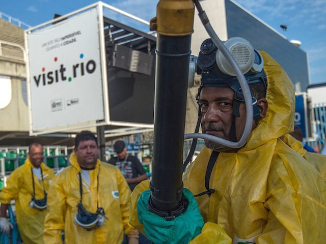 "Municipal agents spray anti Zika mosquitos chimical product at the sambadrome in Rio de Janeiro, on January 26, 2016. Brazil is mobilizing more than 200,000 troops to go ""house to house"" in the battle against Zika-carrying mosquitoes, blamed for causing horrific birth defects in a major regional health scare, a …"