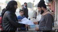 IS militants handed out leaflets in the Syrian city of Raqqa instructing the public about ways to deal with the flu.