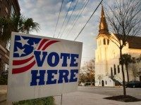 A 'vote here 'sign stands outside a polling station across from the Emanuel African Methodist Episcopal Church in Charleston, South Carolina, on February 20, 2016.