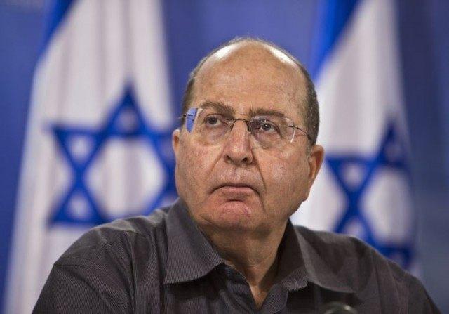 Defense Minister Moshe Ya'alon attends a news conference in Tel Aviv.