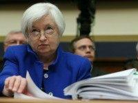 Federal Reserve Board Chairwoman, Janet Yellen looks over her papers during a House Financial Services Committee hearing on Capitol Hill, February 10, 2016 in Washington, DC. Ms. Yellen is delivering the Federal Reserve's semi-annual Monetary Policy Report to the House Committee. (Photo by )