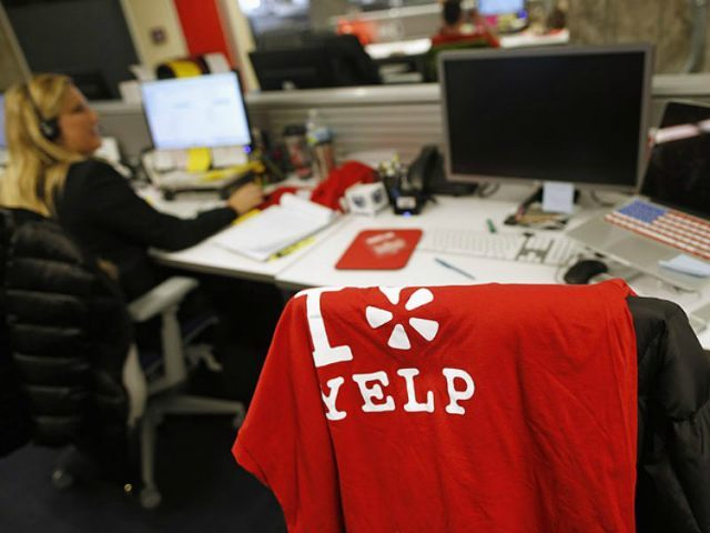 An employee works in the Yelp Inc. offices in Chicago, Illinois, March 5, 2015. REUTERS/JIM YOUNG