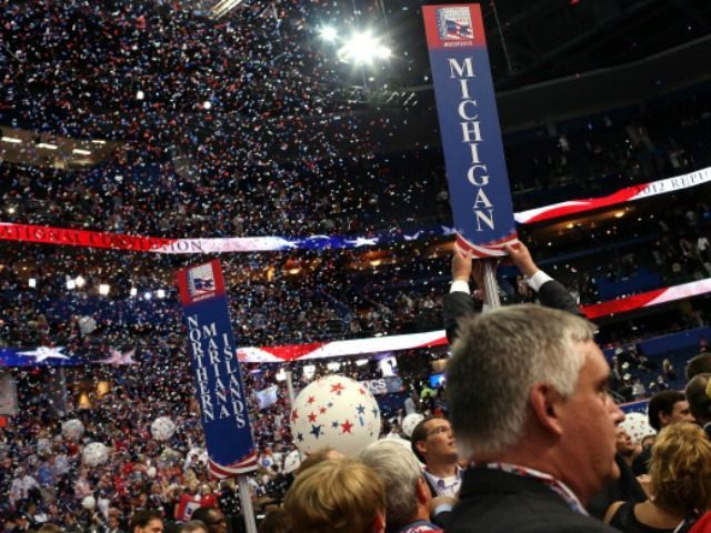 A person removes the sign for the Michigan delegation after Republican presidential candidate, former Massachusetts Gov. Mitt Romney accepted the nomination during the final day of the Republican National Convention at the Tampa Bay Times Forum on August 30, 2012 in Tampa, Florida.
